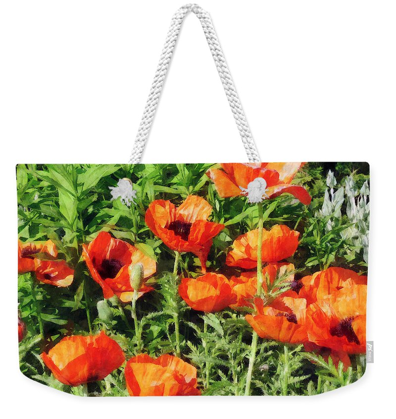 Poppy Weekender Tote Bag featuring the photograph Field Of Red Poppies by Susan Savad