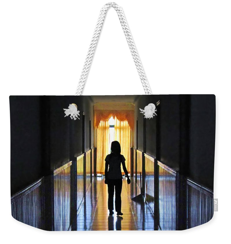 Contrast Weekender Tote Bag featuring the photograph Figure In The Corridor by Mark Sellers