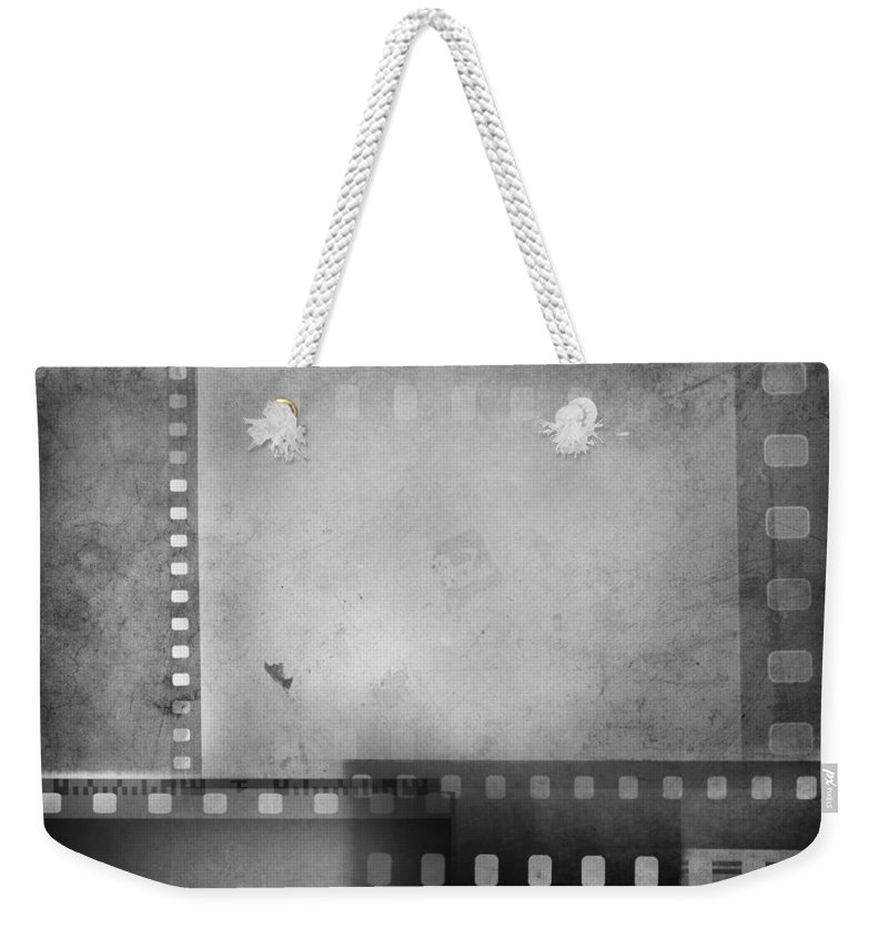 Grey Weekender Tote Bag featuring the photograph Film Negatives by Les Cunliffe