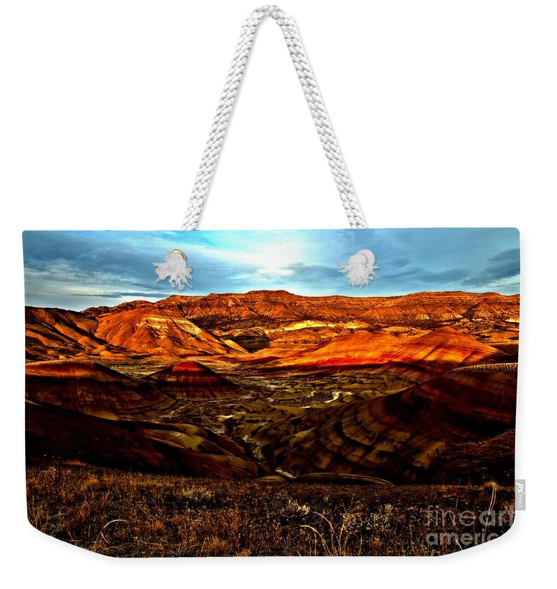 John Day Fossil Beds Weekender Tote Bag featuring the photograph Fire In The Painted Hills by Adam Jewell