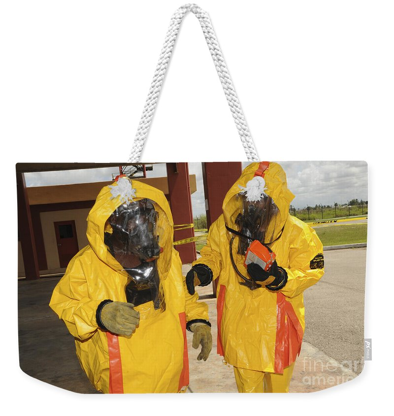 Firefighters Dressed In Hazmat Suits Weekender Tote Bag For Sale By Stocktrek Images