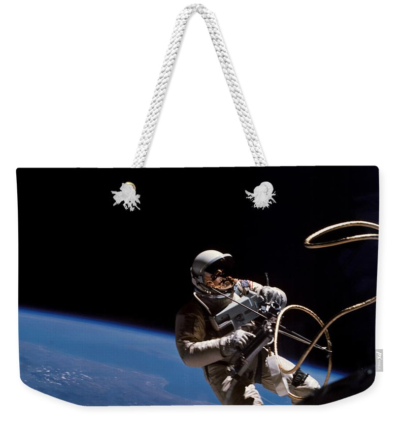 Ed White Weekender Tote Bag featuring the photograph First U.s. Spacewalk by Nasa