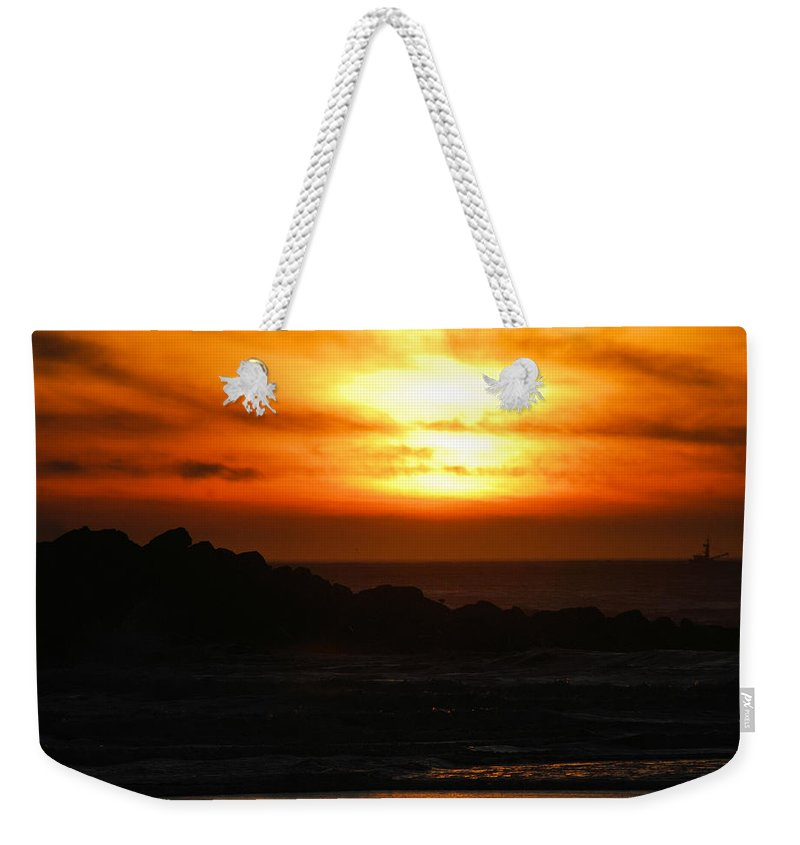 Sunset Weekender Tote Bag featuring the photograph Fishing Vessel At Sunset by Michael Merry