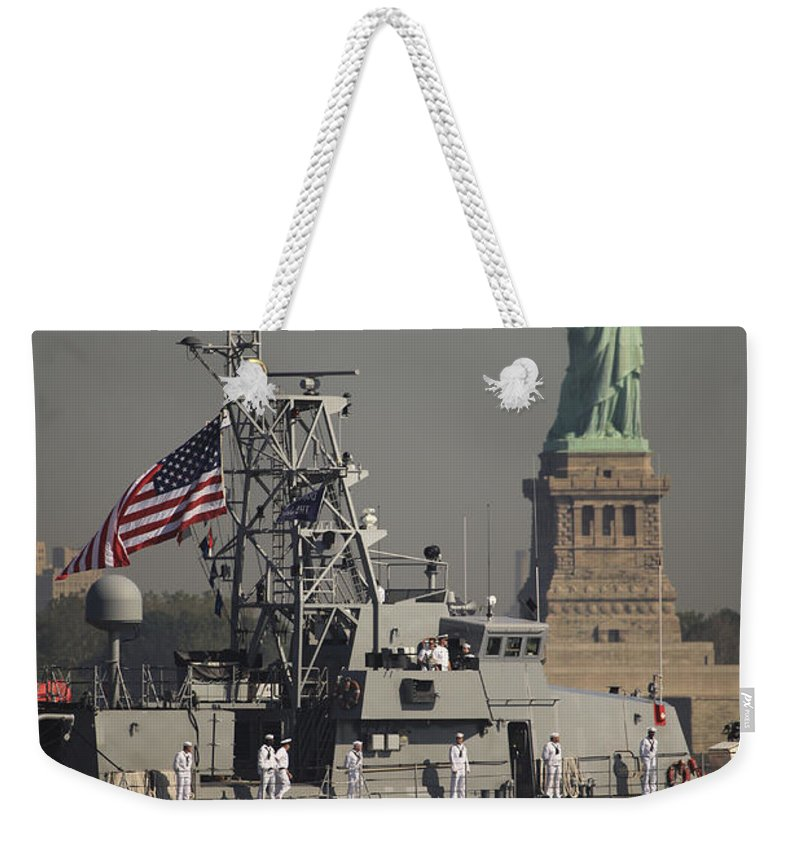 Liberty Island Weekender Tote Bag featuring the photograph Fleet Week Vessels Pass By The Statue by Stocktrek Images