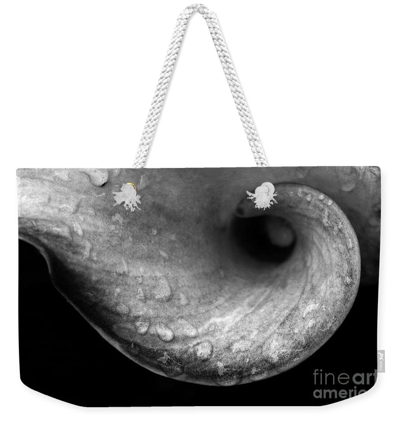 Flower Weekender Tote Bag featuring the photograph Flower Curl Against Black Bw by Mike Nellums