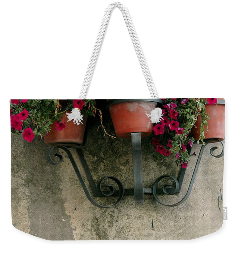 Flower Weekender Tote Bag featuring the photograph Flower Pots On Old Wall by Mike Nellums