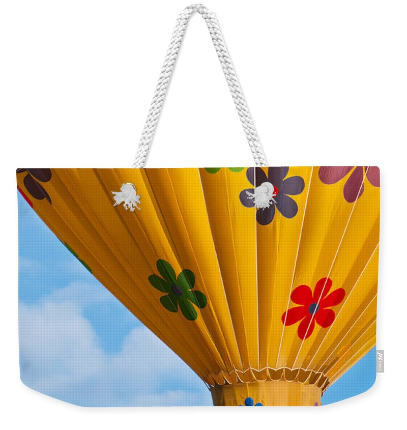 Hot Weekender Tote Bag featuring the photograph Flower Power by Colleen Coccia