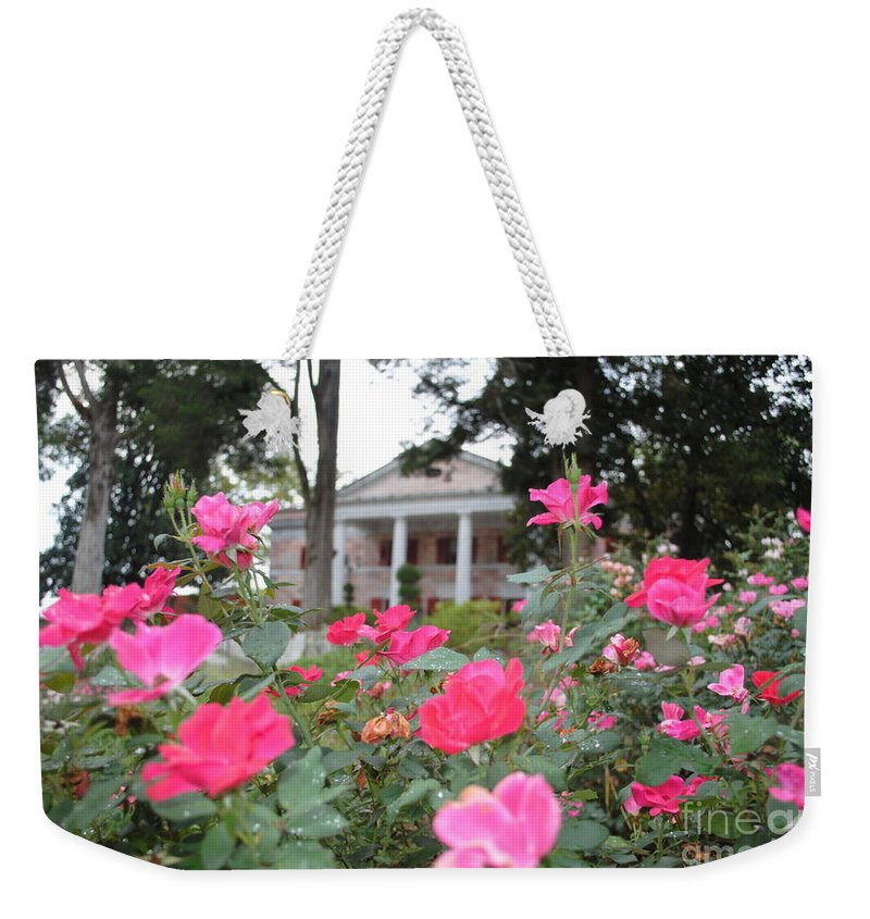 Tate Weekender Tote Bag featuring the photograph Flowers Of Tate by Jost Houk