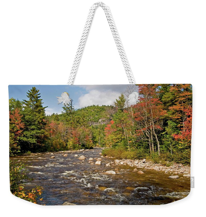 white Mountains Weekender Tote Bag featuring the photograph Flowing Into Autumn by Paul Mangold
