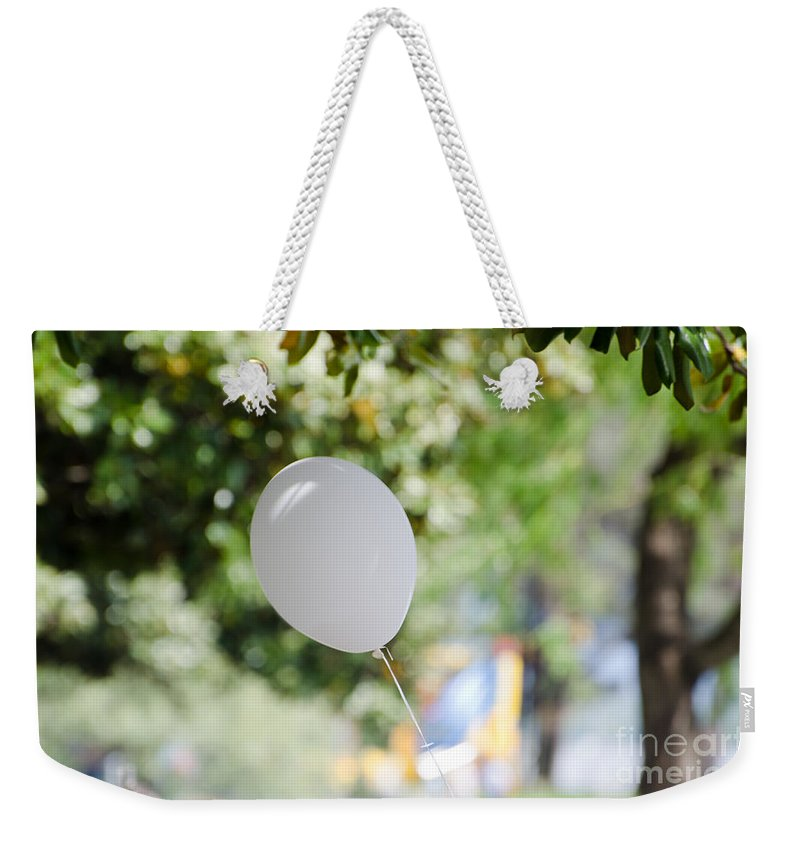 Balloon Weekender Tote Bag featuring the photograph Flying Balloon by Mats Silvan