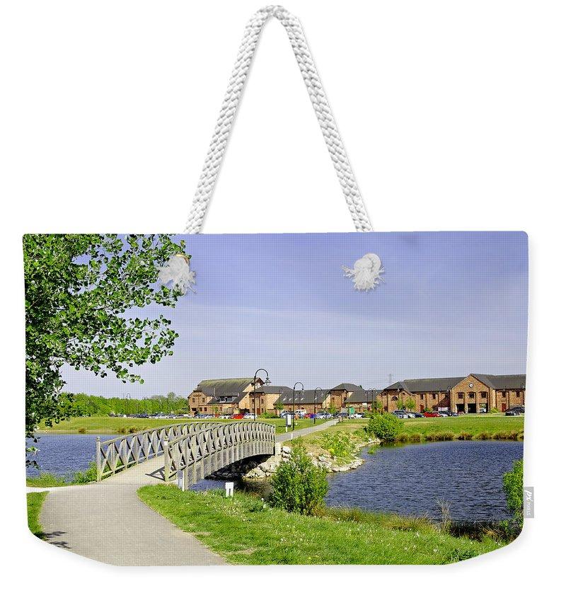 Water Weekender Tote Bag featuring the photograph Foot-bridge And Lake - Barton Marina by Rod Johnson