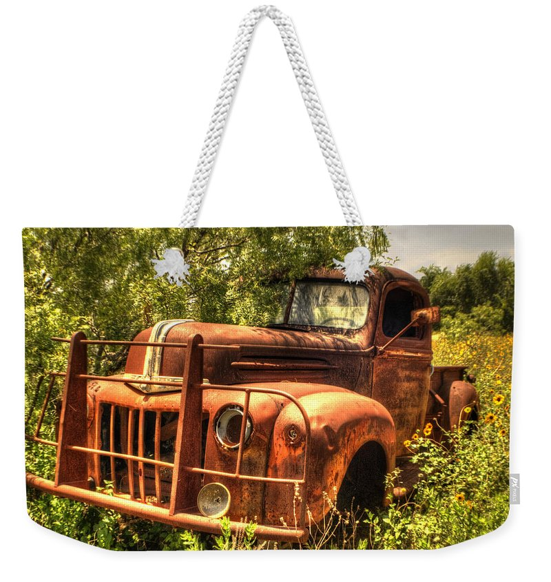 Ford Weekender Tote Bag featuring the photograph Ford In The Weeds by Beth Gates-Sully