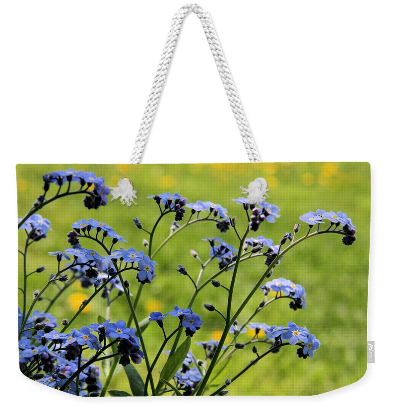 Forget-me-not Weekender Tote Bag featuring the photograph Forget-me-nots by Doris Potter