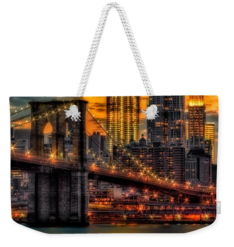 Brooklyn Bridge Weekender Tote Bag featuring the photograph Freedom Rising by Susan Candelario