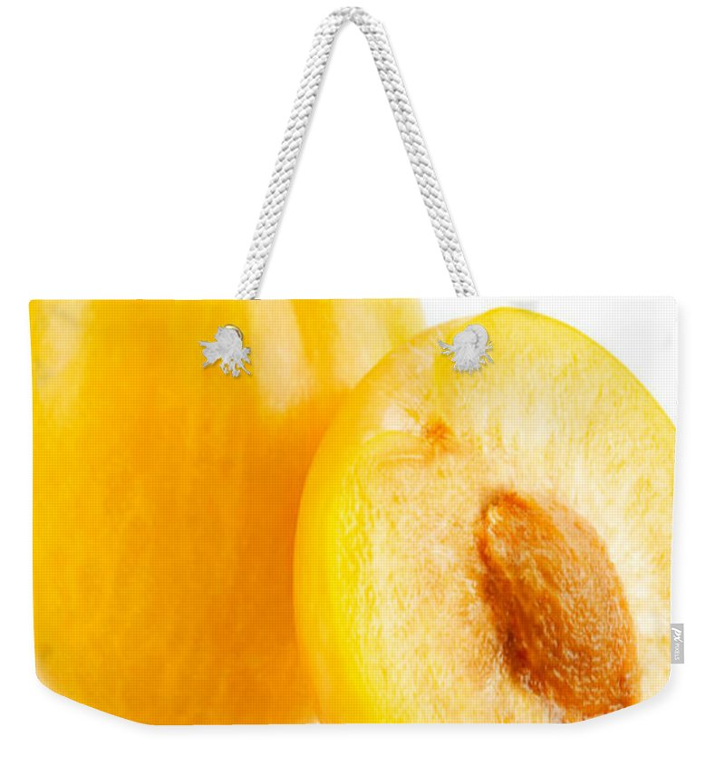Agriculture Weekender Tote Bag featuring the photograph Fresh Plums by Jeelan Clark