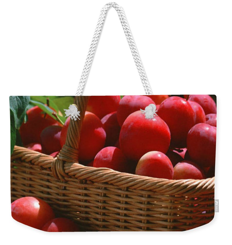 Agriculture Weekender Tote Bag featuring the photograph Fresh Red Plums In The Basket by Jeelan Clark