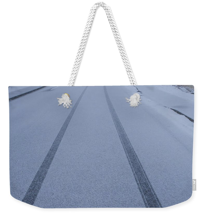 Day Weekender Tote Bag featuring the photograph Fresh Tire Tracks In The Snow by John Burcham