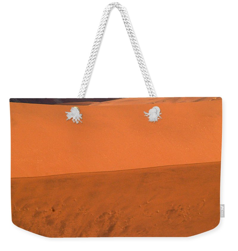 Africa Weekender Tote Bag featuring the photograph From Afar by Alistair Lyne