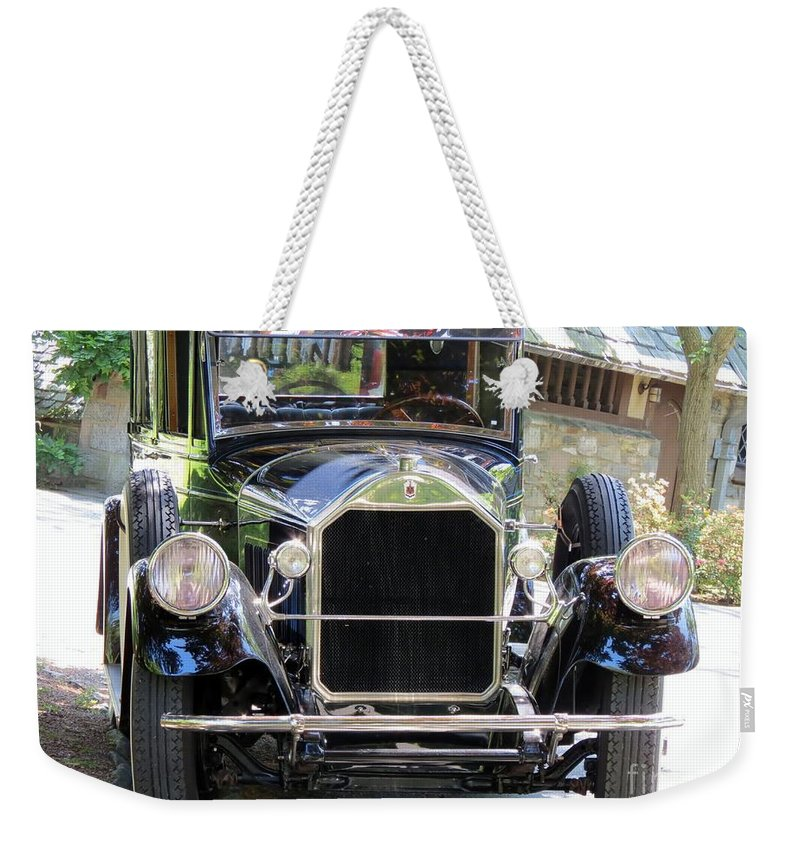 Model Weekender Tote Bag featuring the photograph Front And Center by Art Dingo