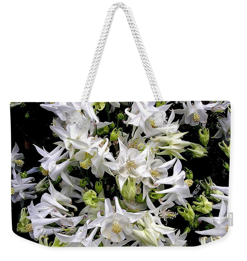 Columbine Weekender Tote Bag featuring the photograph Garden Fairies by Byron Varvarigos