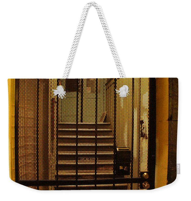 Gated Weekender Tote Bag featuring the photograph Gated Stairwell At Night by Mick Anderson