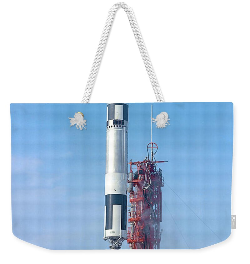 1965 Weekender Tote Bag featuring the photograph Gemini Vi Lifts Off From Its Launch Pad by Stocktrek Images
