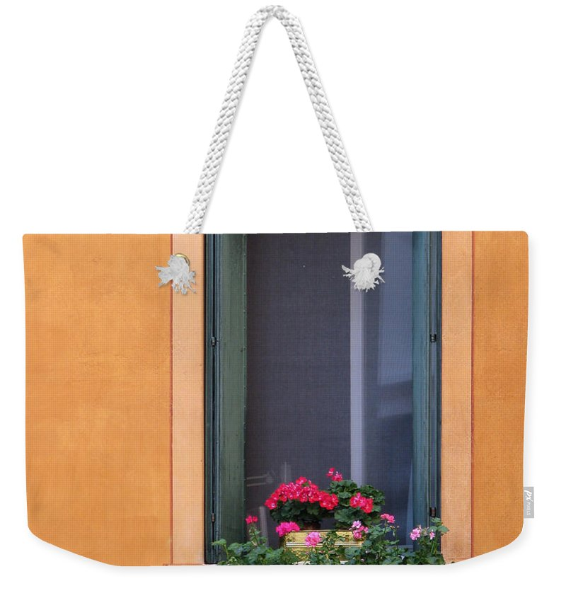 Geraniums Weekender Tote Bag featuring the photograph Geraniums In A Yellow Window In Treviso Italy by Greg Matchick