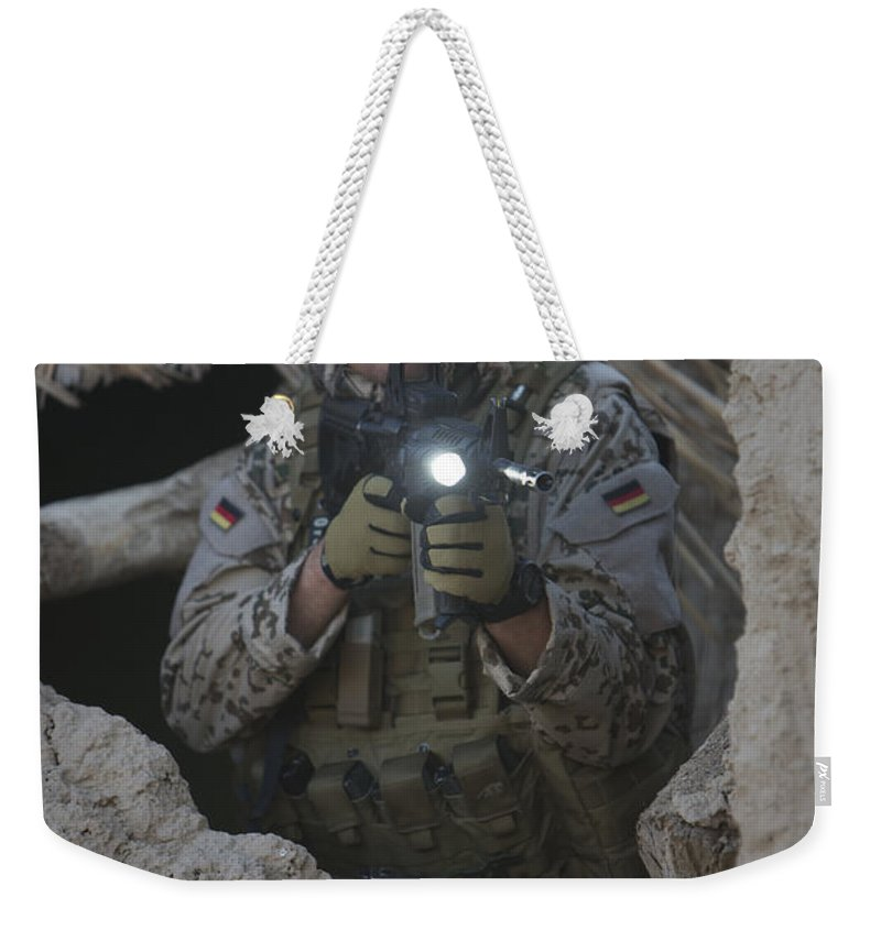 Operation Enduring Freedom Weekender Tote Bag featuring the photograph German Army Soldier Armed With A M4 by Terry Moore