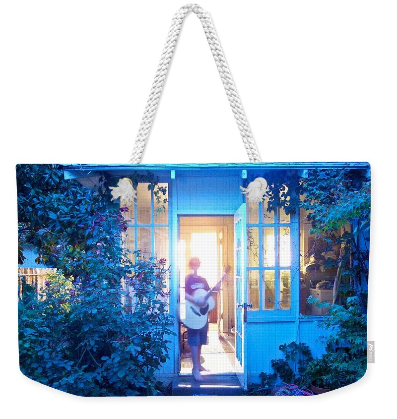 Guitar Weekender Tote Bag featuring the photograph Ghostly Guitarist by Eric Tressler