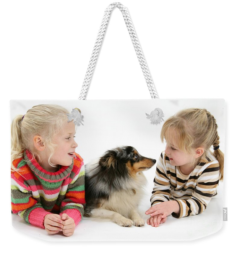 Animal Weekender Tote Bag featuring the photograph Girls And Shetland Sheepdog by Mark Taylor