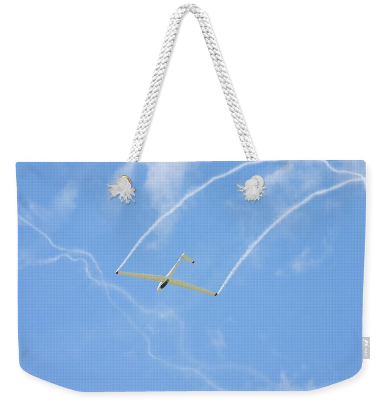 Plane Weekender Tote Bag featuring the photograph Glider Aerobatics Against Blue Sky Canvas Poster Photo Print by Keith Webber Jr