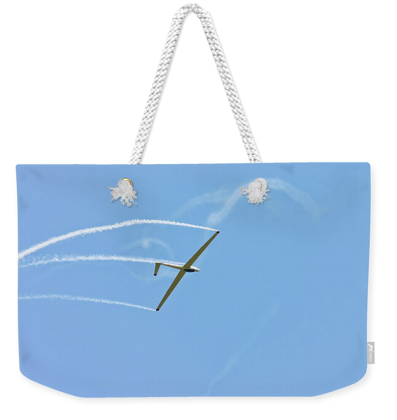 Plane Weekender Tote Bag featuring the photograph Glider Flying Aerobatics At Airshow Phot Canvas Poster Print by Keith Webber Jr