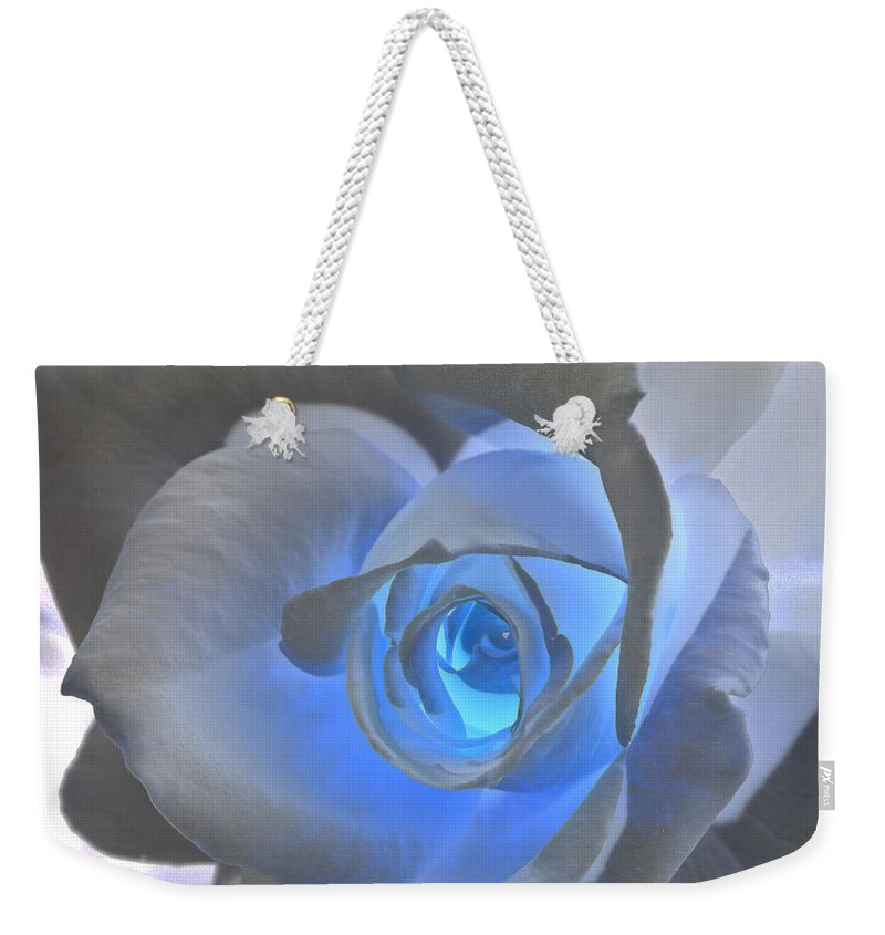 Rose Weekender Tote Bag featuring the photograph Glowing Blue Rose by Phyllis Denton