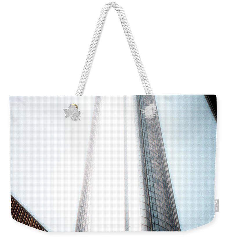 Skyscraper Weekender Tote Bag featuring the photograph Glowing Skyscraper by Mike Nellums