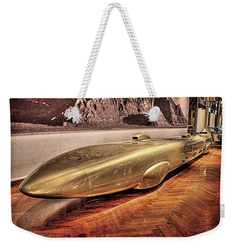 Weekender Tote Bag featuring the photograph Golden Rod Dearborn Mi by Nicholas Grunas