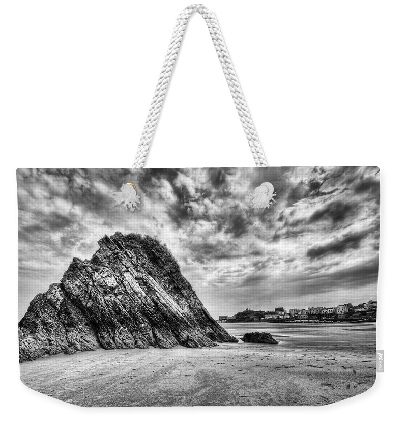 Goscar Rock Tenby Weekender Tote Bag featuring the photograph Goscar Rock Tenby 2 Mono by Steve Purnell
