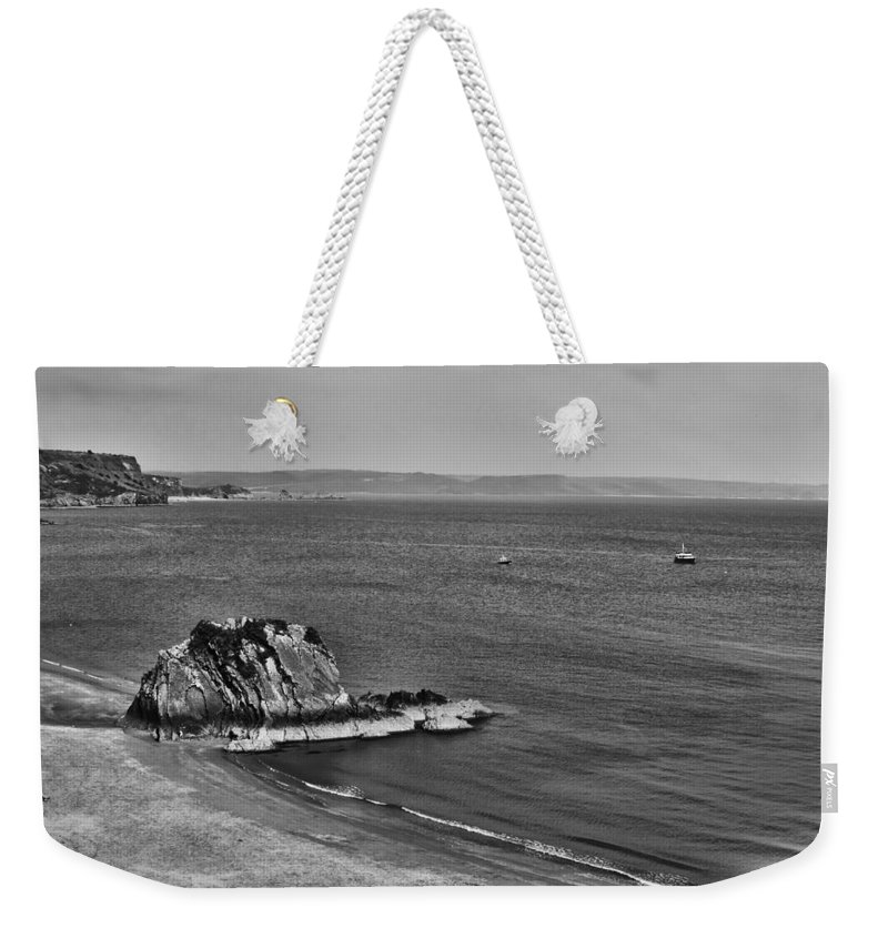 Goscar Rock Tenby Weekender Tote Bag featuring the photograph Goscar Rock Tenby Mono by Steve Purnell