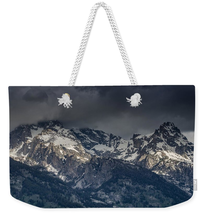 Grand Tetons National Park Weekender Tote Bag featuring the photograph Grand Tetons Immersed In Clouds by Greg Nyquist