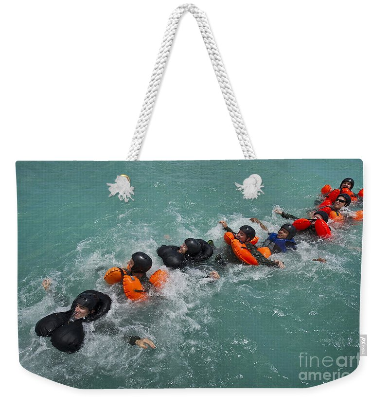 Military Weekender Tote Bag featuring the photograph Group Swimming Technique During A Water by Stocktrek Images