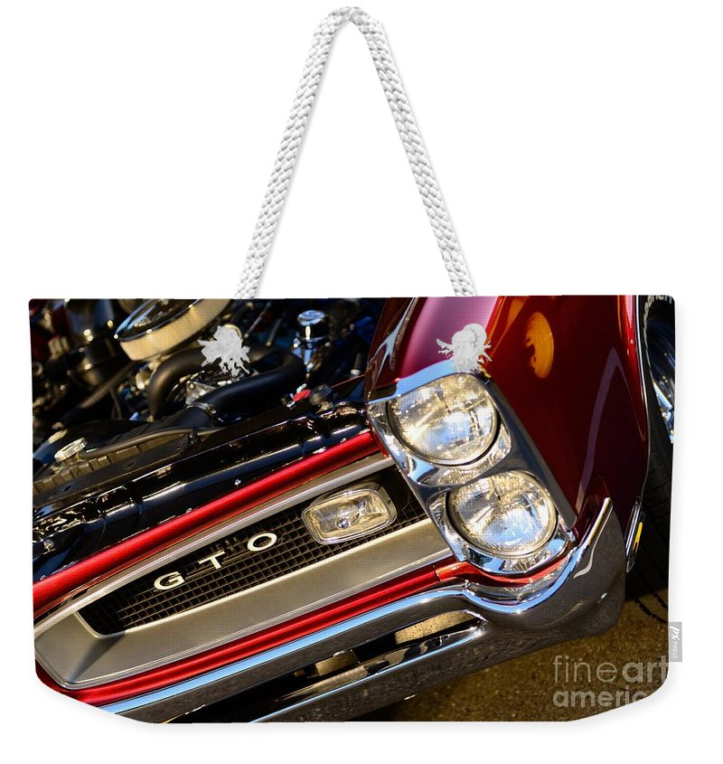 Gto Weekender Tote Bag featuring the photograph GTO by Paul Ward