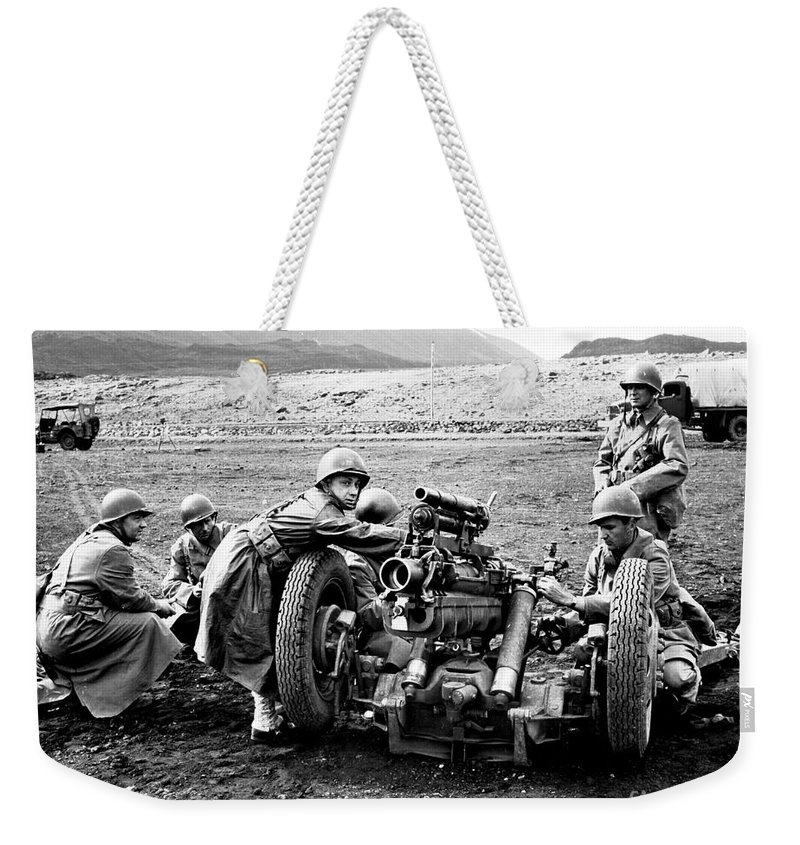 War Weekender Tote Bag featuring the photograph Gun Crew Prepares To Fire A 37mm by Stocktrek Images