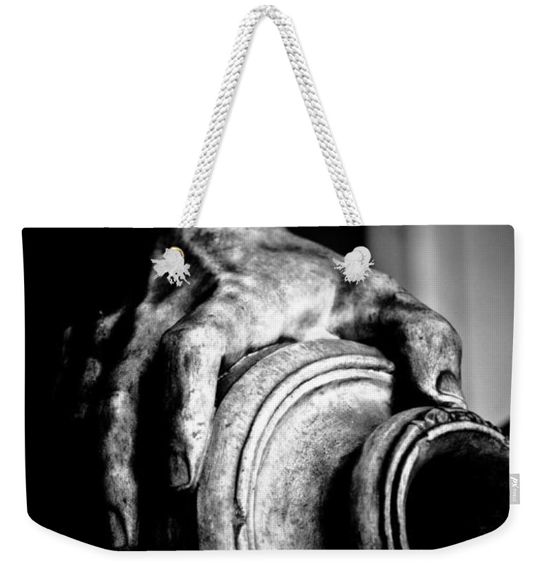 Black Weekender Tote Bag featuring the photograph Hand And Vessel by Hakon Soreide