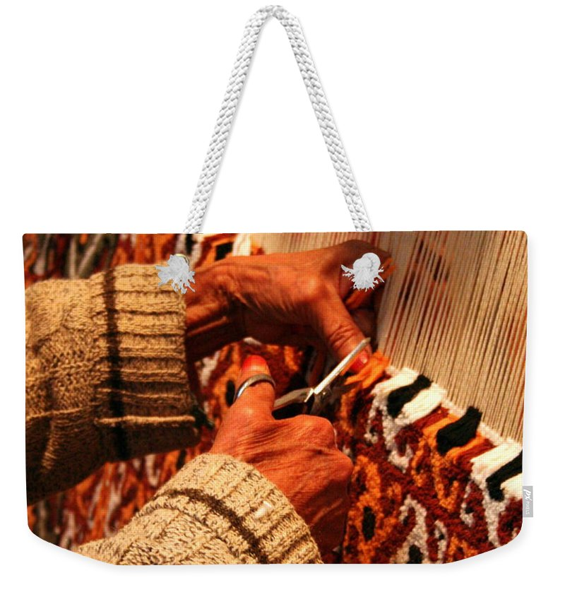 Carpet Weekender Tote Bag featuring the photograph Hands Of The Carpet Weaver by Laurel Talabere