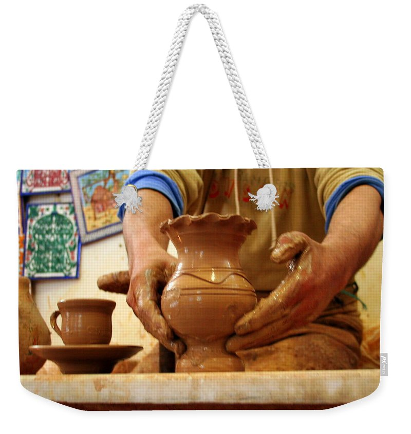 Hands Weekender Tote Bag featuring the photograph Hands Of The Potter by Laurel Talabere