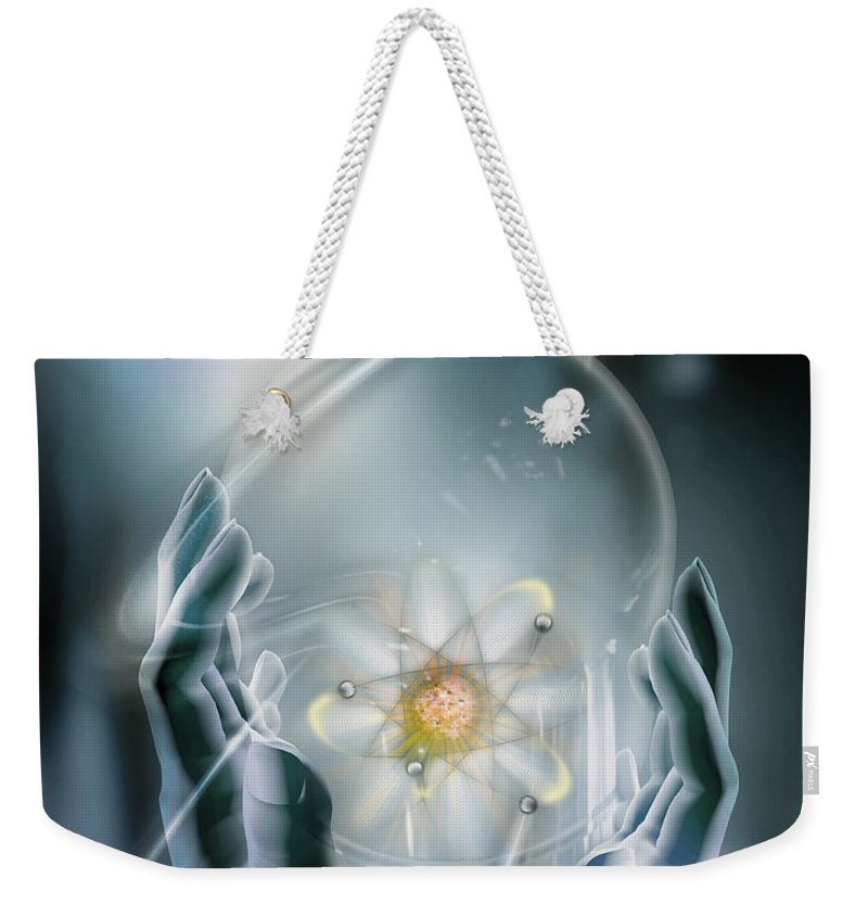 Atom Weekender Tote Bag featuring the photograph Hands With Atom In Capsule by Mike Agliolo and Photo Researchers