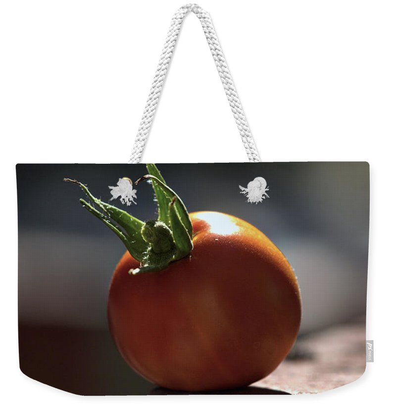 Tomato Weekender Tote Bag featuring the photograph Hang On by Joe Schofield