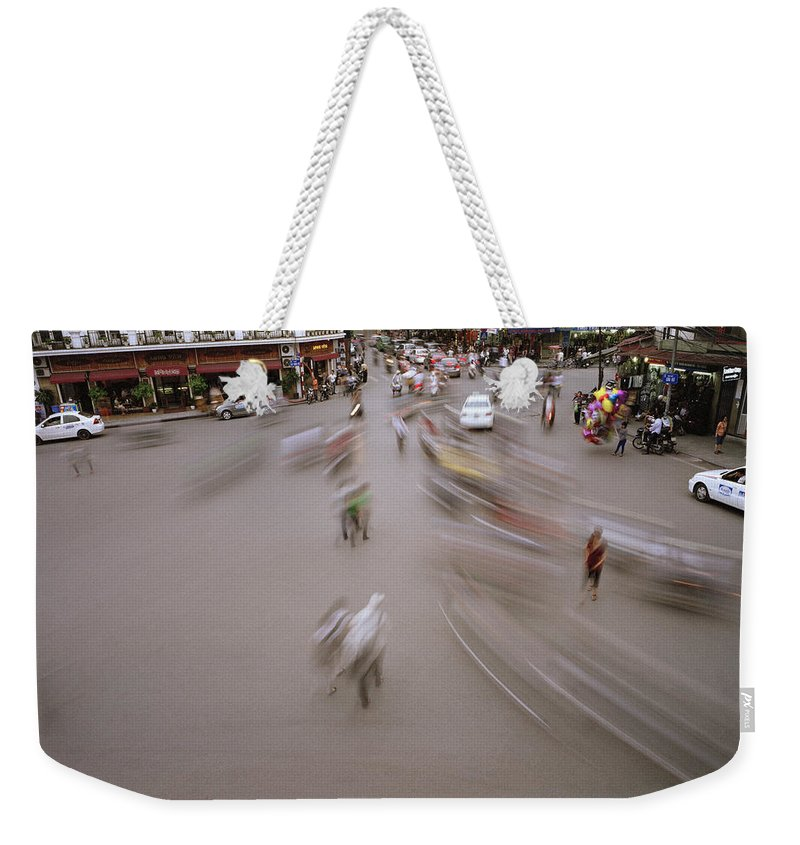 Asia Weekender Tote Bag featuring the photograph Hanoi Motion by Shaun Higson