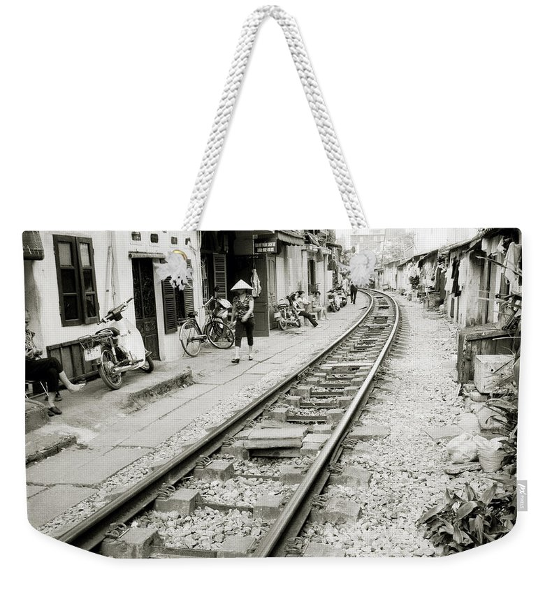 Asia Weekender Tote Bag featuring the photograph Hanoi Railway by Shaun Higson