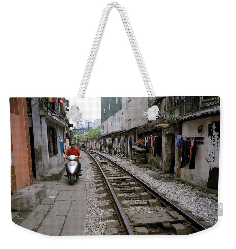 Asia Weekender Tote Bag featuring the photograph Hanoi Train Tracks by Shaun Higson