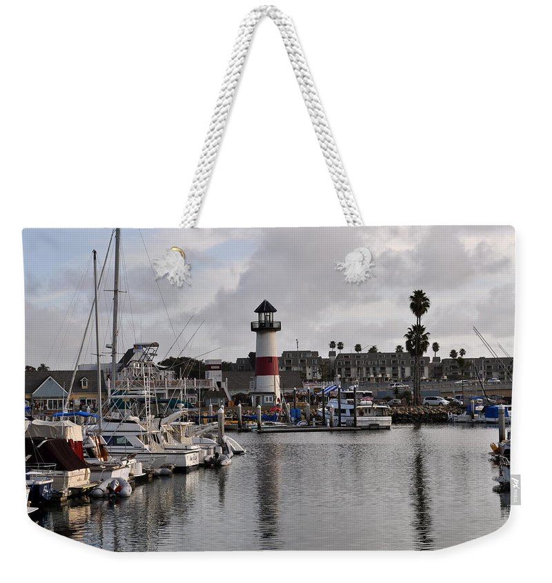 Oceanside Weekender Tote Bag featuring the photograph Harbor Lighthouse by Bridgette Gomes